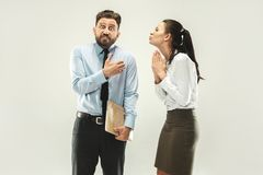 Angry boss. Man and his secretary standing at office or studio. Business men with his colleague. Female and male caucasian models. Office relationships concept Royalty Free Stock Image