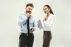 Angry boss. Man and his secretary standing at office or studio. Business man pointing to camera with his colleague. Female and male caucasian models. Office Royalty Free Stock Images
