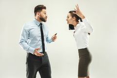 Angry boss. Man and his secretary standing at office or studio. Business man pointing to camera with his colleague. Female and male caucasian models. Office Stock Photo