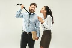 Angry boss. Man and his secretary standing at office or studio. Business men with his colleague. Female and male caucasian models. Office relationships concept Stock Photo