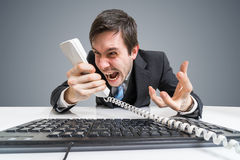 Angry boss or manager is calling and shouting to the telephone Stock Photo