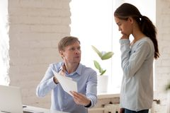 Angry boss, mentor scolding upset female intern for mistake in d. Ocuments, criticizing subordinate work results, financial report, looking with disapproval stock photography