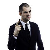 Angry boss. Pointing a finger at employee and warning him Royalty Free Stock Image
