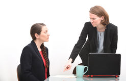 Angry boss reprimanding employee at a business meeting Stock Photography