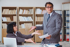 The angry boss reprimanding fellow employee Royalty Free Stock Image