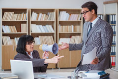 The angry boss reprimanding fellow employee Royalty Free Stock Photos