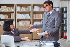 The angry boss reprimanding fellow employee Royalty Free Stock Photography