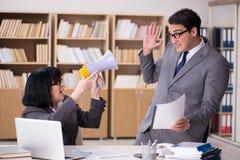 The angry boss reprimanding subordinate employee stock photos