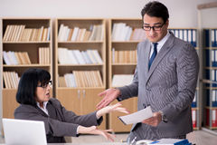 The angry boss reprimanding subordinate employee Royalty Free Stock Photo