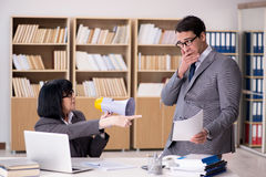 The angry boss reprimanding subordinate employee Royalty Free Stock Images