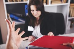 Angry boss with sad worker royalty free stock photography