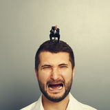 Angry boss screaming at crying man Stock Images