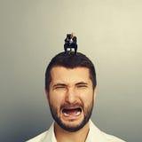 Angry boss screaming at crying man Stock Images