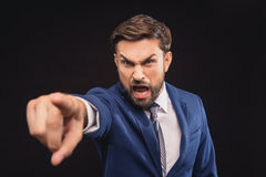 Angry boss screaming with irritation Stock Photos