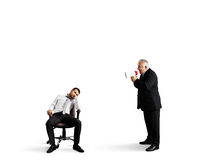 Angry boss screaming at lazy worker Royalty Free Stock Image