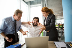 Angry boss screaming at workers. Angry bosses men and women screaming, shouting and yelling at their worker. Handsome men having stress and closing with ears Stock Photography