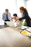 Angry boss screaming at workers. Mobbing, stress, work, scandal concepts. Angry bosses men and women screaming at their executive worker, because they are not Stock Photography