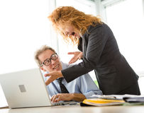 Angry boss screaming at workers Stock Photos