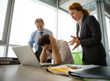 Angry boss screaming at workers. Mobbing, stress, work, scandal concepts. Angry businessman shouting at his workers with an expressive look. Angry bosses men Stock Photos