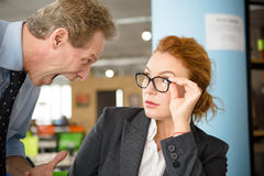 Angry boss screaming at workers Stock Image