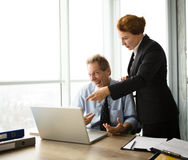 Angry boss screaming at workers Stock Images