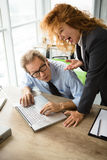 Angry boss screaming at workers. Mobbing, stress, work, scandal concepts. Angry red haired boss women screaming at her worker in office. Businessman having Royalty Free Stock Photo