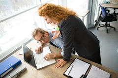 Angry boss screaming at workers. Mobbing, stress, work, scandal concepts. Angry boss women screaming at her worker and expressing negative emotions in office Stock Image