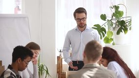 Angry boss shouting at group office meeting scolding criticizing employees stock video