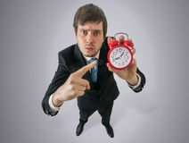 Angry boss is showing clock. Discipline at work concept. View from top stock photos