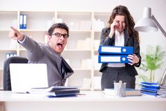 The angry boss unhappy with female employee performance royalty free stock image