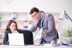 The angry boss unhappy with female employee performance. Angry boss unhappy with female employee performance Royalty Free Stock Images