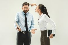 Angry boss. Woman and secretary standing at office or studio. Business men with his colleague. Female and male caucasian models. Office relationships concept Stock Photography