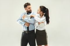 Angry boss. Woman and secretary standing at office or studio. Business men with his colleague. Female and male caucasian models. Office relationships concept Stock Photo