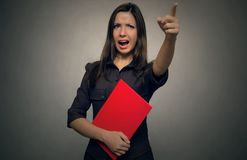 Angry teacher. Wicked boss. Angry boss woman swears and screams on somebody and showing on exit by her hand. Bad executed job. You are fired concept. Chastise a royalty free stock photography