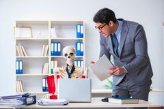 The angry boss yelling at his skeleton employee Royalty Free Stock Image