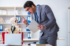 The angry boss yelling at his skeleton employee Stock Photo