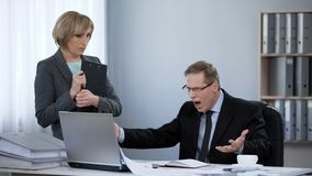 Angry boss yelling at new assistant, nervous breakdown, inappropriate behavior. Stock photo stock image