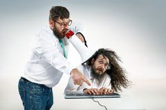 Angry boss yelling to an office worker stock photography