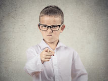 Angry bossy boy pointing finger at someone. Closeup portrait angry, mad child disguised as boss, executive businessman, pointing finger at someone, displeased Stock Images
