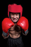 Angry boxer with gloves and headgear Royalty Free Stock Photography