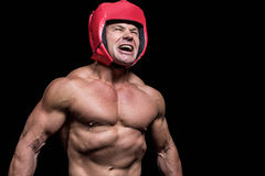 Angry boxer with headgear Stock Photography