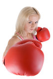 Angry boxing woman in red box gloves Royalty Free Stock Image