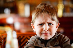 Angry boy. Lifestyle portrait of 4 years old angry boy stock image
