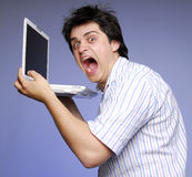 Angry boy. With notebook in hands. 1 Stock Photography