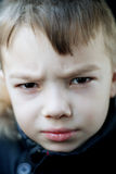 Angry boy. Portrait of little boy 6 years old, angry and displeased Royalty Free Stock Images
