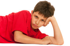 Angry boy. An angry boy in red; isolated on the white background, displeasure Stock Photos