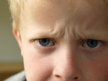 Angry boy. Angry 6 year old boy frustrated at his parents Stock Images