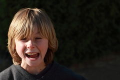 Angry boy. Face of a little boy being angry royalty free stock image
