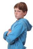 Angry boy. Portrait of an angry young boy on white background stock photo