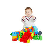 Angry boy. With colorful plastic toys isolated on white Stock Photos